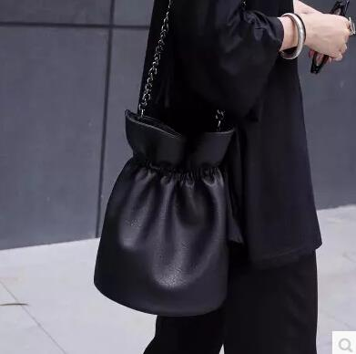 Black fringed shoulder bag diagonally across the bag