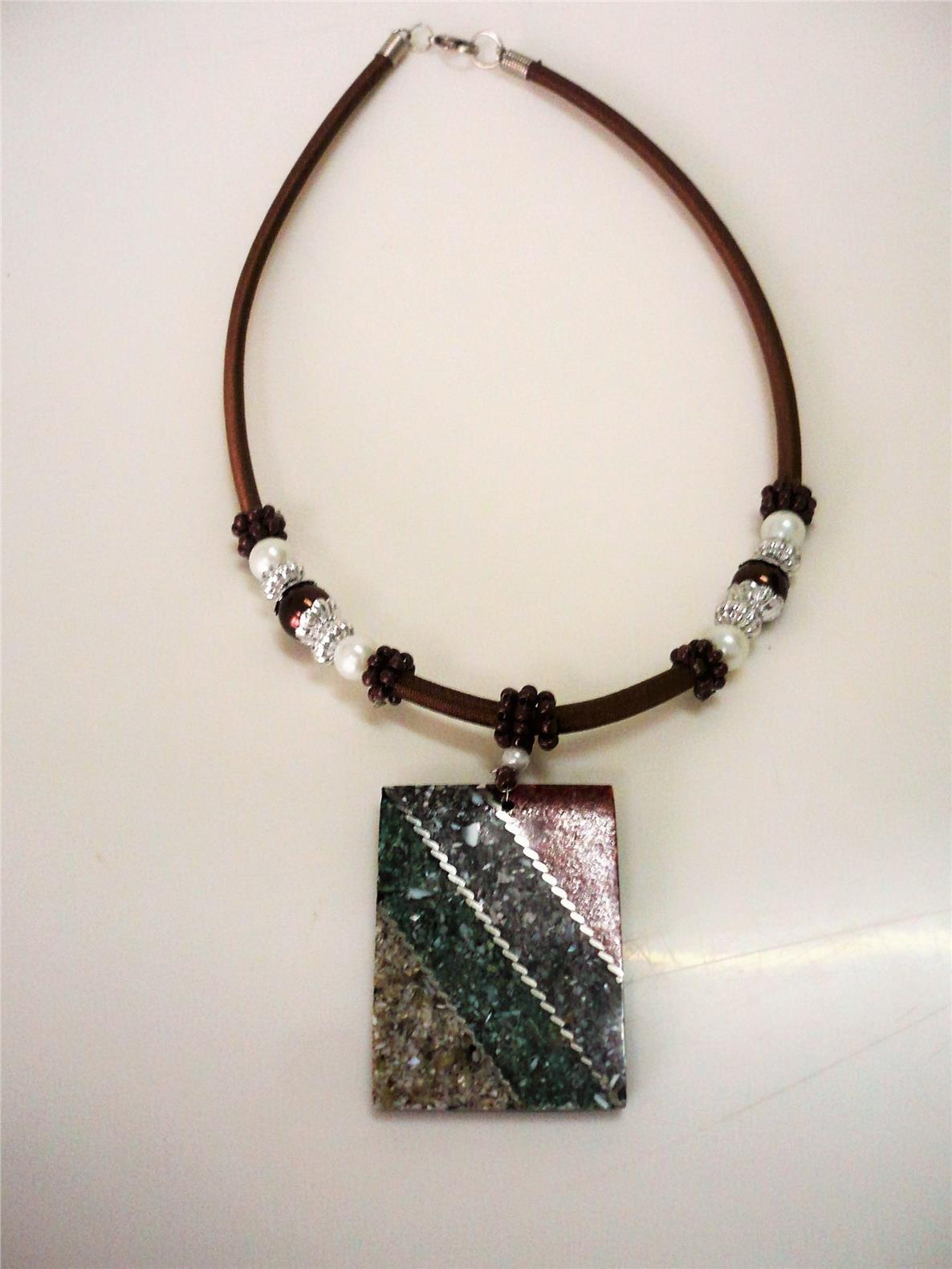 Brown waxed cord choker with beads and a rectangular-shaped pendant