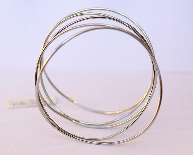 flowing wave bangle, rhodium plated