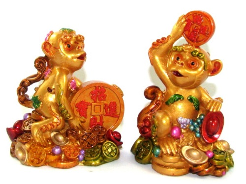 Pair of Cheeky Monkeys Hoarding Treasures for Wealth Accumulation