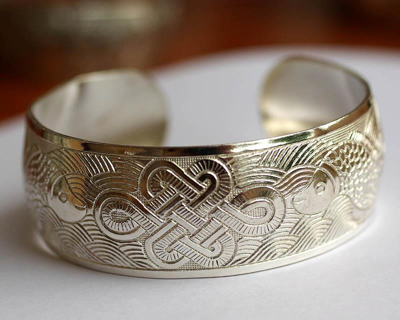 silver bangle with gold fish & harmony knot artwork from Hanoi