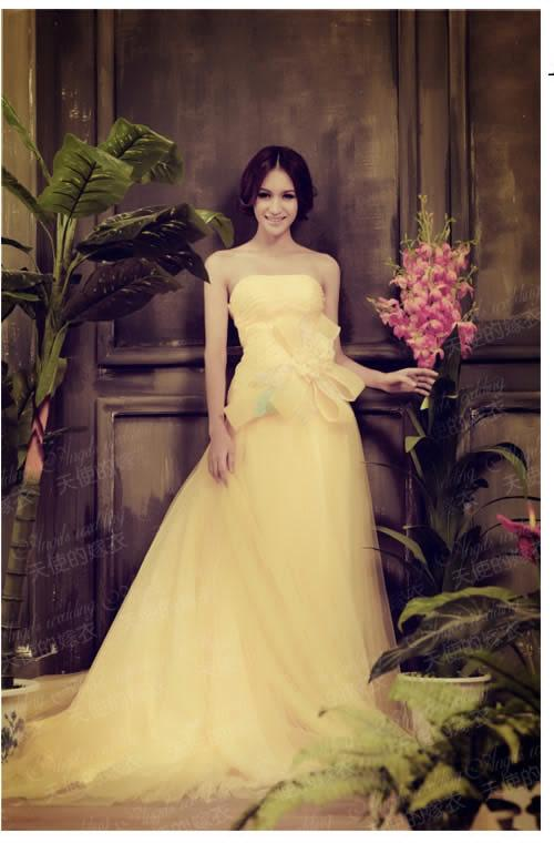 Soft Yellow Colour Wedding gown dresses with Low chest cutting