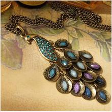 **BeautyMyth** Prancing Peacock Jingle Long Pendant Necklace