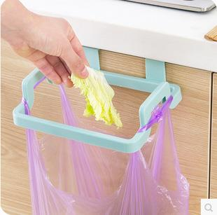 Multi Function Rubbish Bag Holder at the door of Cupboard