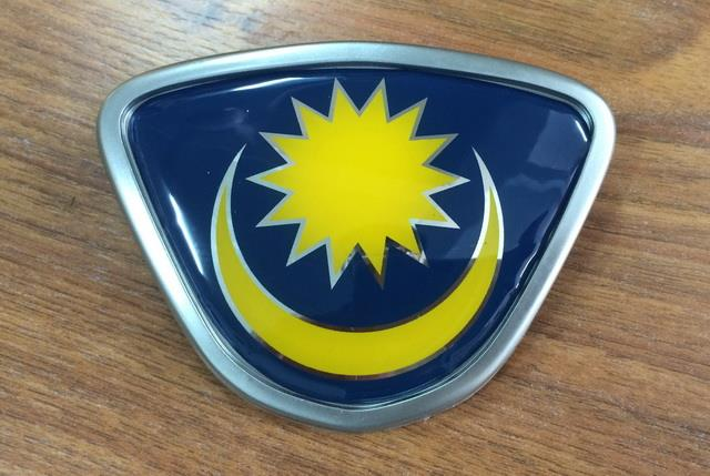 Wira Front Grille Emblem